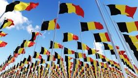 Many Belgium Flags against blue sky. Stock Photos