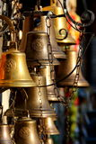 Many bells closeup. Many copper bells closeup in the shop stock photo