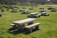 Many benchs and stone tables in a park Stock Photos