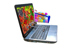 many of berries on a laptop screen, stylized vitamins in the food trolley Royalty Free Stock Image