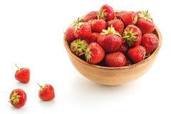 Many berries ripe juicy strawberries in a wooden plate Royalty Free Stock Image