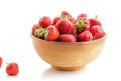 Many berries ripe juicy strawberries in a wooden plate Stock Photo