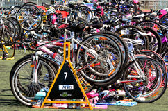 Many bicycle during a triathlon competition. GOLD COAST - OCT 05 2014:Many bicycle waiting at triathlon competition station.A triathlon is a multiple-stage Royalty Free Stock Photography