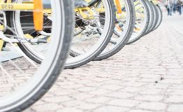 Many bicycles parked on the parking. Many wheels of bicycles parked on a bicycle parking stock photos