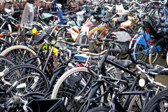 Many bicycles in racks at train station Royalty Free Stock Photos