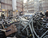 Many bicycles on street of Amsterdam city, parking ideal traffic eco healthy lifestyle concept close up at sunlight Royalty Free Stock Photos