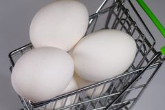 Many big eggs in a shopping trolley. Easter shopping Royalty Free Stock Photography