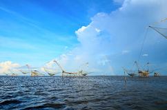 Many The big Fish lift nets in lake and rainbow Royalty Free Stock Image