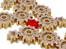 Many big golden gears with one red. In the middle stock photography