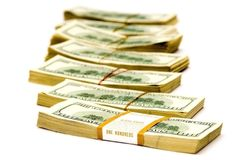 Many big packs of dollars over white ($70 000) Stock Photography