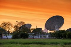 big satelite dishes with twilight sky royalty free stock photo