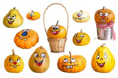 Many big and small pumpkins with face. In front of a white background royalty free stock photo