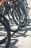 Many bike wheels closeup Royalty Free Stock Photos