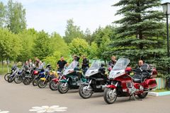 Many bikers motorcyclists with colorful motorcycles in the parking lot. Minsk, Belarus, 28.0.2018 royalty free stock photo