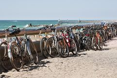 Many bikes along the beach Royalty Free Stock Photos