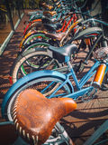 Many bikes in a row on the street. Bicycle parking. Colored bicycles on the street Stock Image