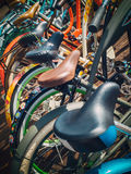 Many bikes in a row on the street. Bicycle parking. Colored bicycles on the street Royalty Free Stock Images
