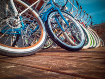 Many bikes in a row on the street. Bicycle parking. Colored bicycles on the street Royalty Free Stock Photos