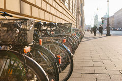 Many bikes in a row on the street in Munich, Germany, Europe. Bicycle parking. Environmentally friendly and healthy Royalty Free Stock Photos