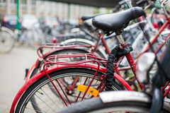 Many bikes standing in bike stands Royalty Free Stock Images