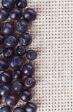 Many bilberry fruits, on gray linen table cloth Stock Photos