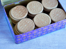 Many biscuit in the blue tin Royalty Free Stock Photo