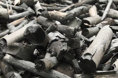 Many black charcoal make from wood stock photos