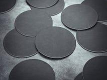 Many black circle beer coasters. 3d rendering Stock Image