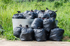 Many black garbage bags in autumn park Royalty Free Stock Images