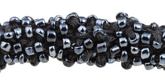 Many black glass beads sewn on necklace close up Stock Images