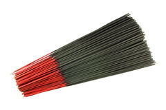 Many black incense sticks on white Stock Photos