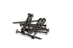 Many black metal bolts and screws isolated on white background Stock Images