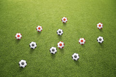Many black and red soccer balls on grass Royalty Free Stock Photo