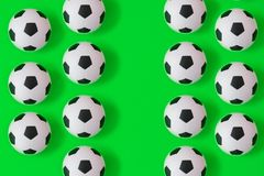 Many black and white soccer balls background. Football balls in a water royalty free illustration
