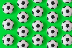 Many black and white soccer balls background. Football balls in a water stock illustration