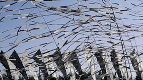 Many black and white tapes sway on wind in summer day. Blue clear sky. Black and white flags. stock video footage