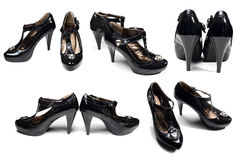 Many  black woman's shoes isolated on white Royalty Free Stock Photos