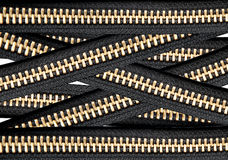 Many black zippers background Royalty Free Stock Images