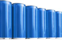 Many blank metal blue cans on table, closeup. Mock up for design royalty free stock image