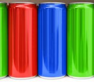 Many blank metal colorful cans on table, closeup. Mock up for design stock photo