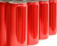 Many blank metal red cans on table, closeup. Mock up for design stock photo