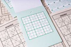 Many blank sudoku crosswords. Popular logic game with numbers Stock Image