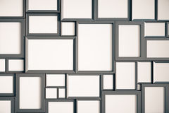 Many blank wooden picture frames on the wall. Mock up Stock Photography
