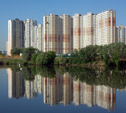 Many block of flats over river and clear blue sky Stock Photography