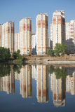 Many block of flats over river and clear blue sky Royalty Free Stock Photos