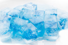 Many blocks of blue ice. Many blocks of ice on white background royalty free stock photos