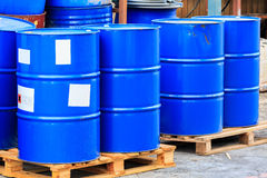 Many blue barrels on wooden pallets Royalty Free Stock Photos