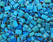 Many blue capacitors as electronics background Royalty Free Stock Photos