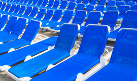 Many blue deck-chairs Royalty Free Stock Image