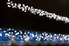 Many blue lights blurred bokeh in the night. Many blue lights blurred bokeh background in the night stock images